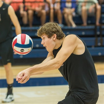 20140609hobuckzspts.jpg Ambridge Area's Brandon Buck, a senior outside hitter, bumps a pass to a teammate in the PIAA Class AA championship match against Northeastern.
