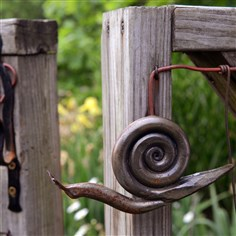 snail-shaped latch Chris Holt created a snail-shaped latch for her garden fence.