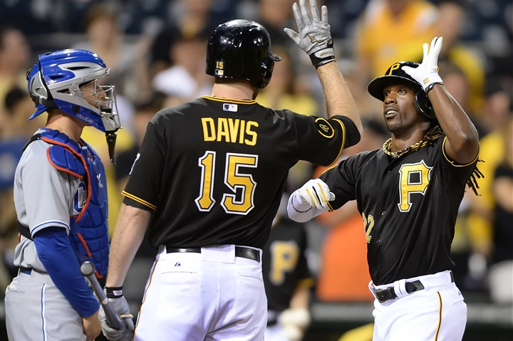20140611pdPiratesSports01 Pirates' Andrew McCutchen is greeted at home by Ike Davis after hitting a two-run homer against the Cubs in the first inning at PNC Park.