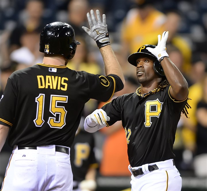 20140611pdPiratesSports01 Pirates' Andrew McCutchen is greeted at home by Ike Davis after hitting a two-run homer against the Cubs in the first inning Wednesday night at PNC Park.