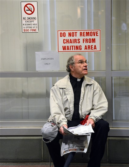 20140612dsClergyLocal04-2 The Rev. Jack O'Malley sits in the hallway waiting for the start of his Hearing. O'Malley was one of nine members of the Clergy of the Pennsylvania Interfaith Impact Network were charged on Feb. 27 over protesting UPMC.
