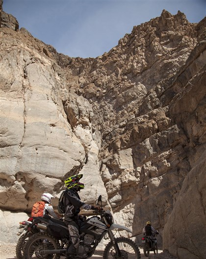 20140611mctDEATHVALLEY3travel-2 Ty van Hooydonk, stops on his Kawasaki KLX250S to look at the beauty of Titus Canyon Narrow.