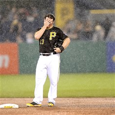 20140612pdPiratesSports07-1 Pirates Travis Snider stands at second base in the rain just before the delay in the 7th inning against the Cubs at PNC Park.