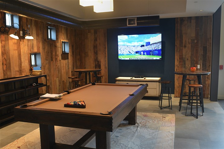 A pool table and large screen television  A pool table and large screen television are two of the recreational features in the lounge at Bakery Square.