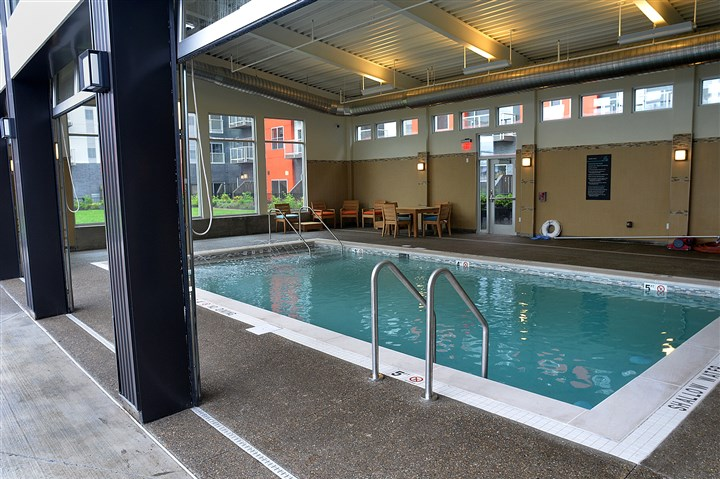 The swimming pool at Bakery Living The swimming pool at Bakery Living has glass walls that can be opened to allow both inside and outside access.
