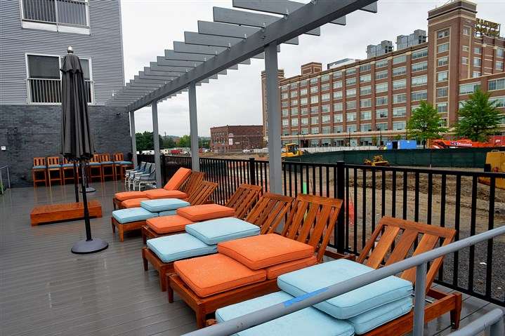raised deck alongside the swimming pool at Bakery Living From the raised deck alongside the swimming pool at Bakery Living, you have a fine view of Bakery Square.