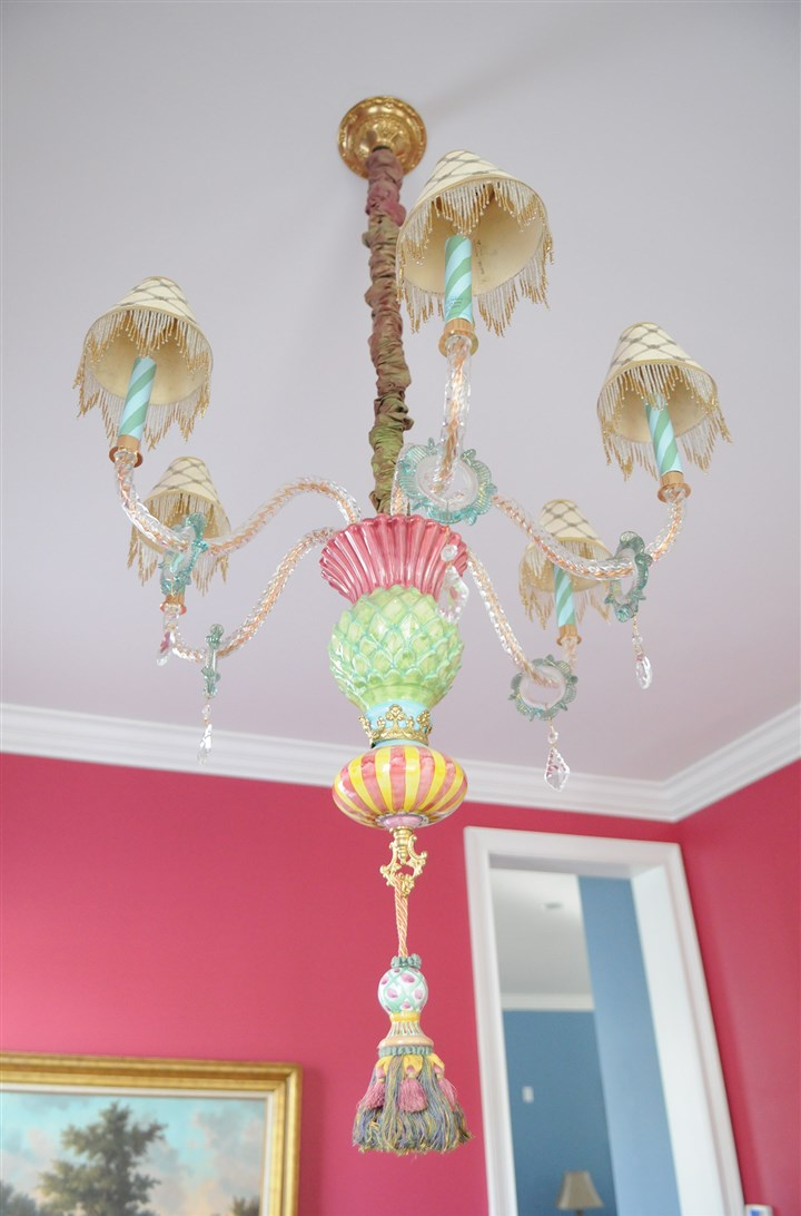 MacKenzie-Childs chandelier The colors of this MacKenzie-Childs chandelier inspired homeowner Margie Garland to paint the walls of her house to match the chandelier.