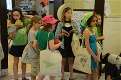 Third-graders wait during transition to another class in June at the Environmental Charter School.