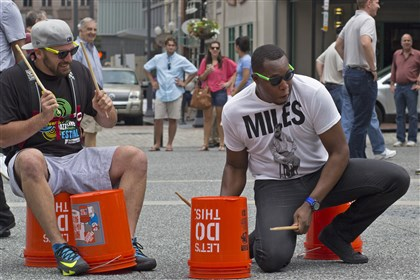 "Jazz Mob Nick Wilson, left, of North Hills, and Jevon Rushton, of Regent Square, play drums in Market Square Friday during a ""Jazz Mob"" to promote the upcoming JazzLive International Festival."