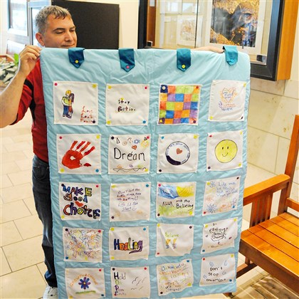 Art show 2014 This quilt, displayed by Mark Bellemare, community service coordinator at Pittsburgh Technical Institute, was made by children of The Bradley Center with the help of PTI students. It was the first piece of art sold during the art show, which runs through July 30.