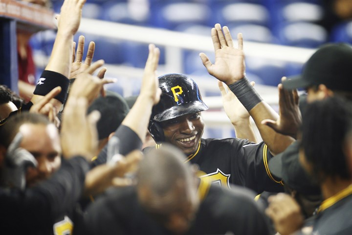 Gregory Polanco celebrates Gregory Polanco celebrates in the dugout after he was driven home by Starling Marte's two-run home run in the first inning Friday in Florida.