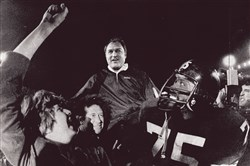Steelers head coach Chuck Noll is carried off the field by his players led by defensive standout Joe Greene after the Steelers won their third Super Bowl. Noll and Greene were named to the NFL's Super Bowl 50 Golden Team.
