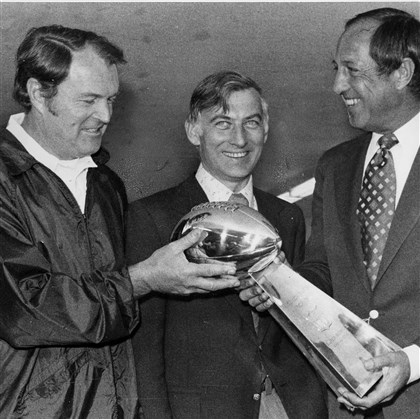 rooneynoll0615 Former Steelers coach Chuck Noll, left, and Dan Rooney, center, accept the Vince Lombardi trophy from then-NFL commissioner Pete Rozelle.