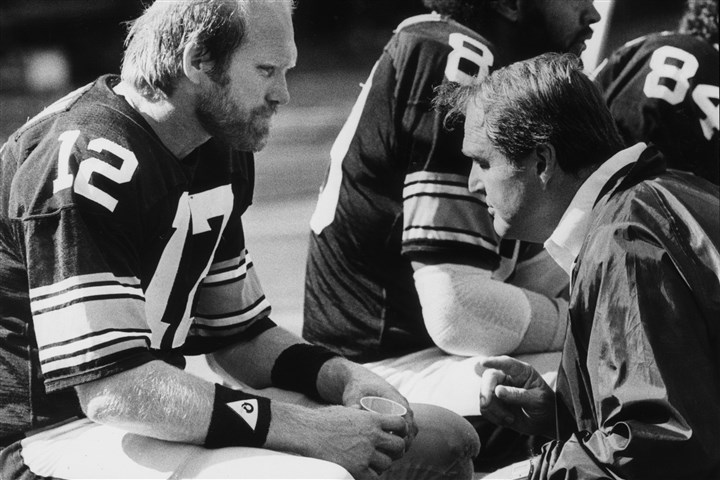 Steelers quarterback Terry Bradshaw and coach Chuck Noll, fall 1981. Steelers quarterback Terry Bradshaw and coach Chuck Noll, fall 1981.