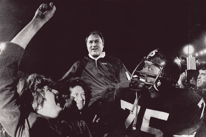 87w00kh7-9 Steelers head coach Chuck Noll is carried off the field by his players led by defensive standout Joe Greene after the Steelers won their third Super Bowl. Noll and Greene were named to the NFL's Super Bowl 50 Golden Team.