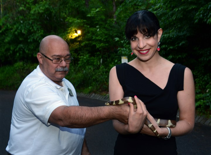 20140613bwZooNseen01 Lou Bruno shows off a California king snake to Natalie Bencivenga.