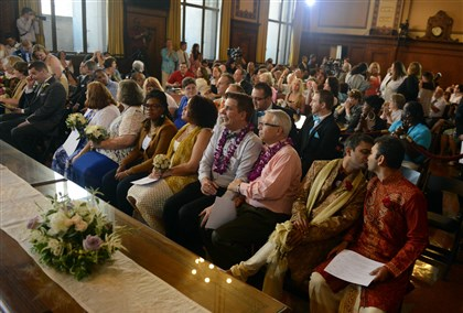 PIttsburgh Gay Pride marriage event Nineteen same-sex couples, including at far right Amit Gokhale, 36, and his fiance, to his left, Sameer Samudra, 39, take their seats as Pittsburgh Mayor Bill Peduto officiates a group same-sex wedding ceremony in celebration of Pennsylvania's newfound marriage equality inside the City Council chambers in the City-County Building on Sunday. Samudra and Gokhale live in Columbus, Ind., and have been together for 10 years.