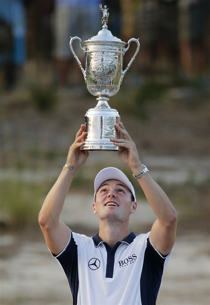 kaymer0616b-1 Martin Kaymer of Germany holds up the trophy after winning the U.S. Open golf tournament Sunday in Pinehurst, N.C.