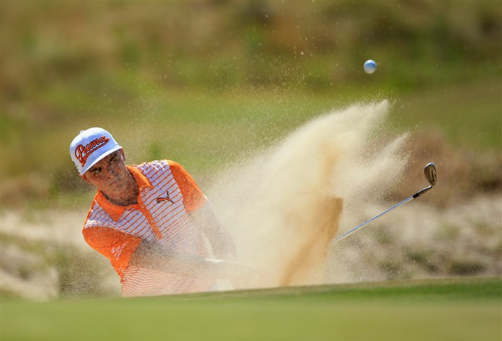 fowler0616 Rickie Fowler of the United States hits his second shot from a bunker on the third hole in the final round Sunday of the 114th U.S. Open at Pinehurst Resort & Country Club
