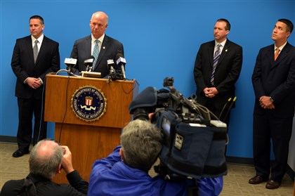 KeithMularski U.S. attorney David J. Hickton takes questions from the media on the recent cyberespionage case at FBI headquarters on the South Side. At left is Scott C. Smith, FBI special agent in charge, and right are J. Keith Mularski, FBI supervisory special agent, and Jimmy Kitchen, assistant U.S. attorney.