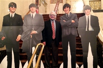 Pat DiCesare at Beatles press conference Pat DiCesare with cutouts of The Beatles at a Monday press conference.