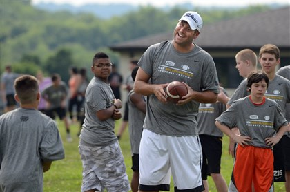 Steelers quarterback Ben Roethlisberger  Ben Roethlisberger works with youths at the Ben Roethlisberger Football Procamp at Seneca Valley High School.
