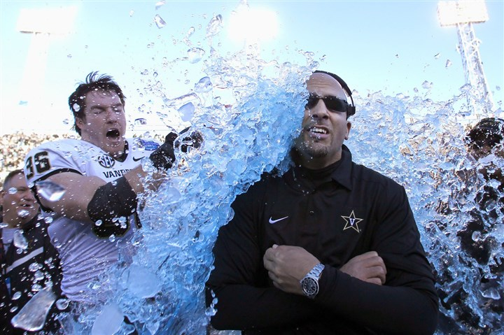 garnham0617-1 Former Vanderbilt coach James Franklin is doused by Chase Garnham after the Commodores won the 2014 BBVA Compass Bowl. Garnham is the only plaintiff to testify who was a current player when he joined the O'Bannon lawsuit.