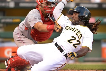 20140617pdPiratesSports03-2 Pirates' Andrew McCutchen is tagged out by Reds catcher Brayan Pena at PNC Park.