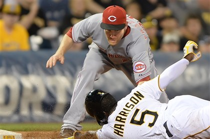 20140617pdPiratesSports05 Pirates' Josh Harrison comes up short and is tagged out by Reds third baseman Todd Frazier at PNC Park.