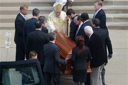 Chuck Noll funeral Bishop David Zubik blesses the coffin containing the body of former Steelers coach Chuck Noll as it arrives at St. Paul Cathedral in Oakland this morning.