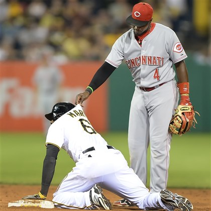 20140617pdPiratesSports06-1 Reds' Brandon Phillips helps up Starling Marte.