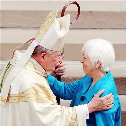 Marianne Noll Bishop David Zubik greets Marianne Noll, widow of former Steelers coach Chuck Noll, before Noll's funeral today at St. Paul Cathedral in Oakland.