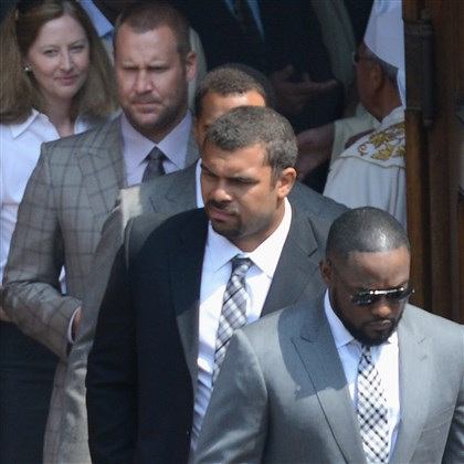 Chuck Noll Steelers Steelers coach Mike Tomlin (foreground) and players Cameron Heyward, and Ben Roethlisberger leave St. Paul Cathedral following Chuck Noll's funeral today.