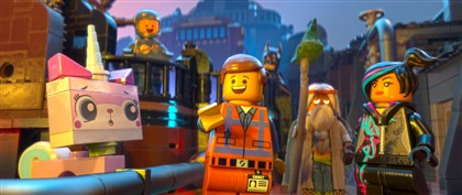"20140619HOLegoMovieDVD-2 LEGO characters Unikitty (voiced by Alison Brie), Benny (Charlie Day), Emmet (Chris Pratt), Batman (Will Arnett), Vitruvius (Morgan Freeman) and Wyldstyle (Elizabeth Banks) in the 3-D animated adventure ""The LEGO Movie."""