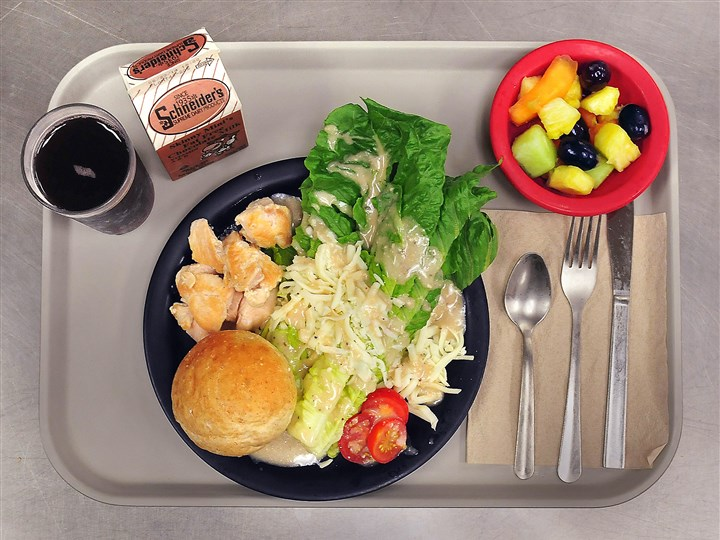lunch7-7 Chef Richard Dyer set out this example of a lunch that meets federal guidelines, including the daily special of chicken Caesar salad and fruit at City Charter High School.