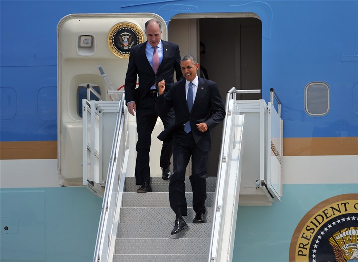 2014617RARlocalobama2-1 President Barack Obama is joined by Sen. Bob Casey as he departs Air Force One after landing at the 171st Air Refueling Wing in Moon Township.