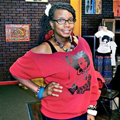 Culture Cloz owner Rukiya McNair  Culture Cloz owner Rukiya McNair in the boutique's East Liberty location before it closed this spring in preparation for the shop's move to Bali, Indonesia.
