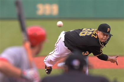 20140618pdPiratesSports02 Pirates pitcher Edinson Volquez delivers against the Reds' Todd Frazier at PNC Park.