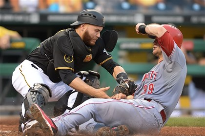 20140618pdPiratesSports03 Pirates catcher Russell Martin is called for blocking the plate allowing the Reds' Devin Mesoraco to score.