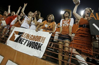 texasfans0618 University of Texas fans cheer on the Longhorns as they play the Rice Owls Sept. 3, 2011 at Darrell K. Royal-Texas Memorial Stadium in Austin, Texas.
