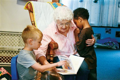 Angel's Place Brookline Pittsburgh Mary Winter, 80, founder of Angel's Place in Brookline, comforts Geno Crenshaw, 4, while reading a book to Cameron Krestal, 4. She founded the organization 30 years ago and still volunteers there cooking lunches.