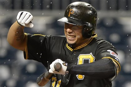 20140618pdPiratesSports07 Pirates' Jose Tabata calls for time as the heavy wind and rain start to fall.