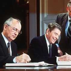 WAS2004060510593 This 1987 file photo shows then U.S. President Ronald Reagan and Soviet leader Mikhail Gorbatchev signing a treaty eliminating US and Soviet intermediate-range and shorter-range nuke missiles.