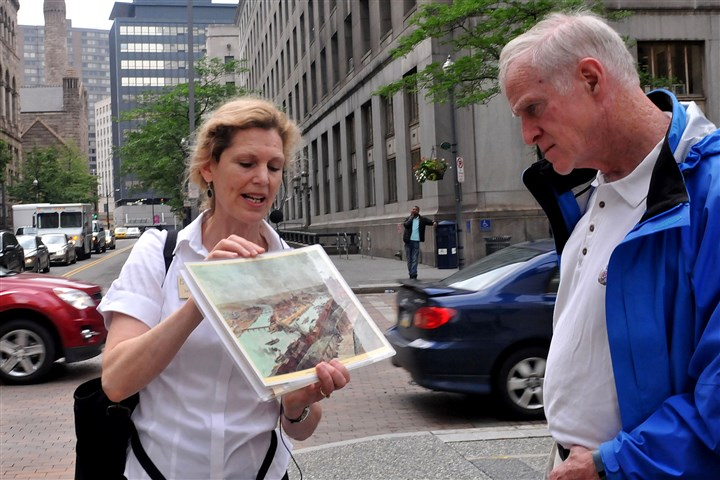 20140618lrtouristambassadors01-4 Louise Sturgess, director of Pittsburgh History & Landmarks Foundation, who gives downtown tours, stands at the corner of Forbes and Grant and describes the layout of the Golden Triangle while Bert Maguire of Pine Township listens.