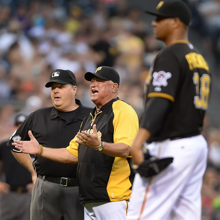 20140618pdPiratesSports06-3 Pittsburgh Pirates manager Clint Hurdle argues a video replay call, in which Russell Martin was called for blocking the plate, scoring the Reds Devin Mesoraco Wednesday night at PNC Park.