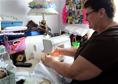 Rose Ann Milbert, a registered nurse who works in the neonatal unit of Magee-Womens Hospital, creates angel gowns, small dresses given to families of babies who died in the hospital.