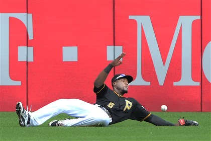 20140619pdPiratesSports08-4 Pirates right fielder Starling Marte can not make the catch on double by the Reds' Zack Cozart at PNC Park.