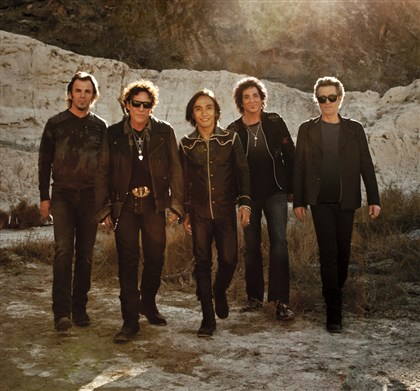 JourneybyTravisShinn From left, Jonathan Cain, Arnel Pineda, Deen Castronovo, Neal Schon and Ross Valory of Journey.