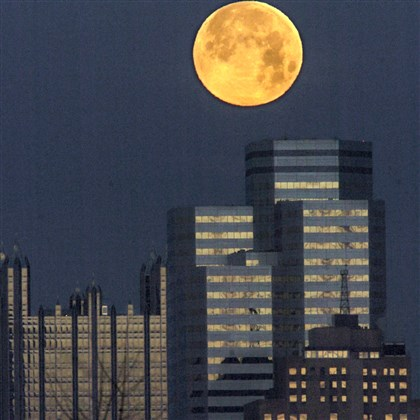 Full moon One Oxford Center A full moon looms over One Oxford Centre, flanked by PPG Place and the Grant Building.