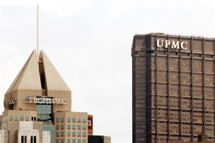 highUPMC Health care giant logos tower over Downtown Pittsburgh.